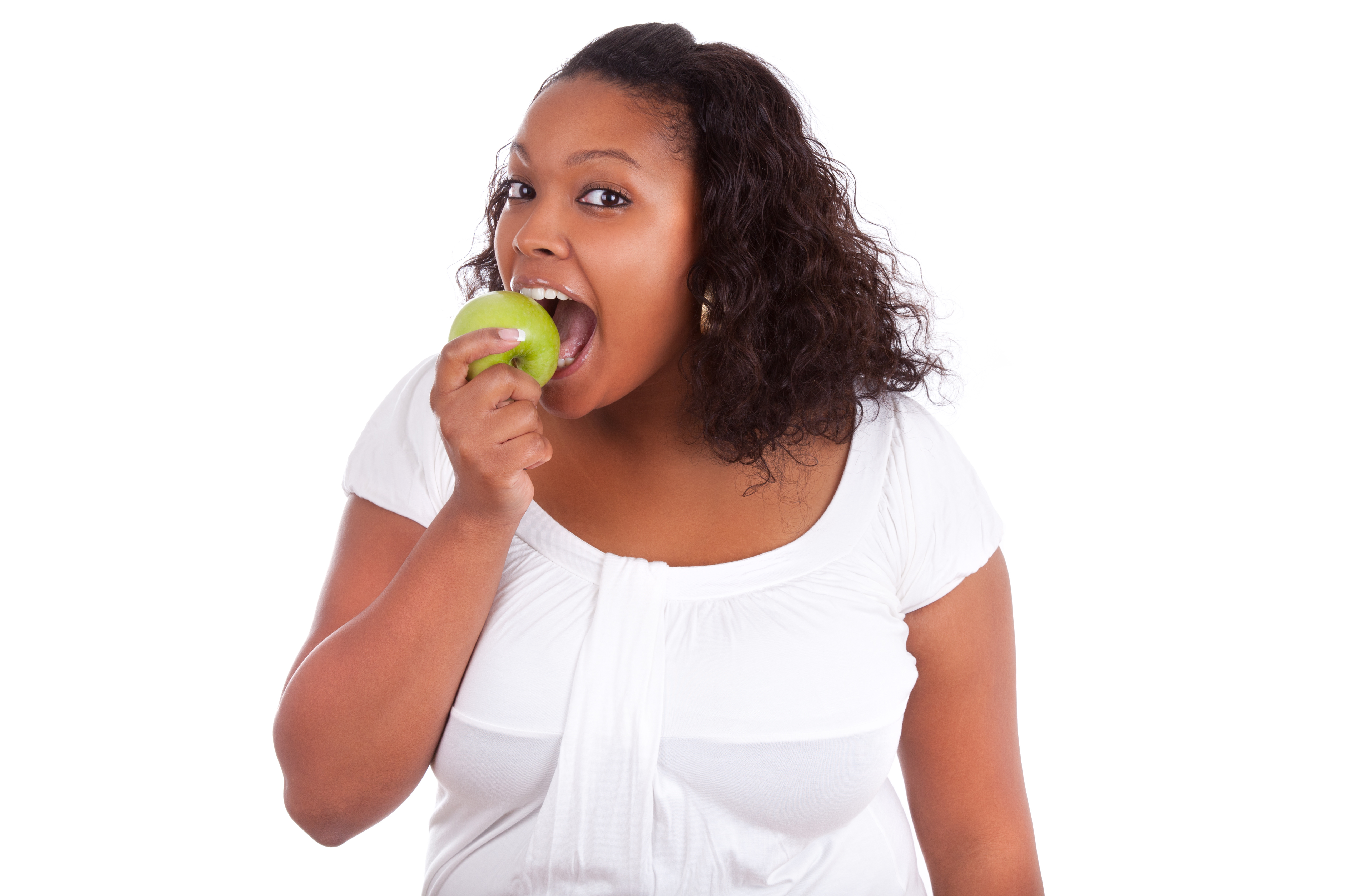 Young african american woman eating an apple